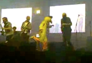 The challenge to get on stage at a concert dressed in a chicken costume.